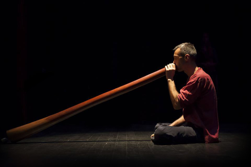 playing didgeridoo